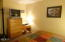 5201 SW US-101, 203, Lincoln City, OR 97367 - Bedroom with TV