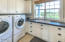 5615 SW Arbor Dr, South Beach, OR 97366 - laundry room