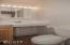 2002 NW Viewridge Dr, Waldport, OR 97394 - Guest Suite Bath - View 1 (850x1280)