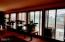 1918 NE Spindrift Ct, Lincoln City, OR 97367 - Wall of west facing windows in LR