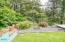 3700 NE Megginson St, Newport, OR 97365 - Firepit overlooking forest
