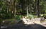 202 N Deer Hill Dr, Waldport, OR 97394 - Stone wall and steps along driveway