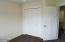 7135 NE Benton Pl, Newport, OR 97365 - Double closets in master bedroom