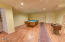 7435 SW Surfland St, South Beach, OR 97366 - Family room.
