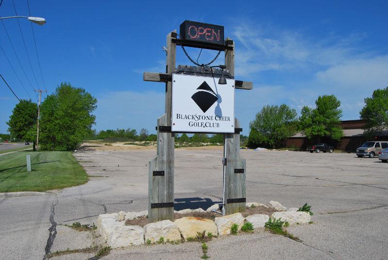 Neighboring Golf Club Sign