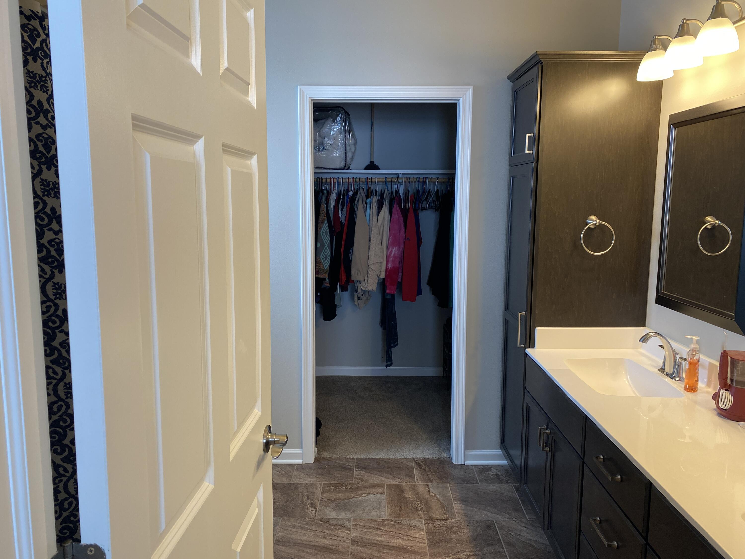 master bathroom view of walk in closet
