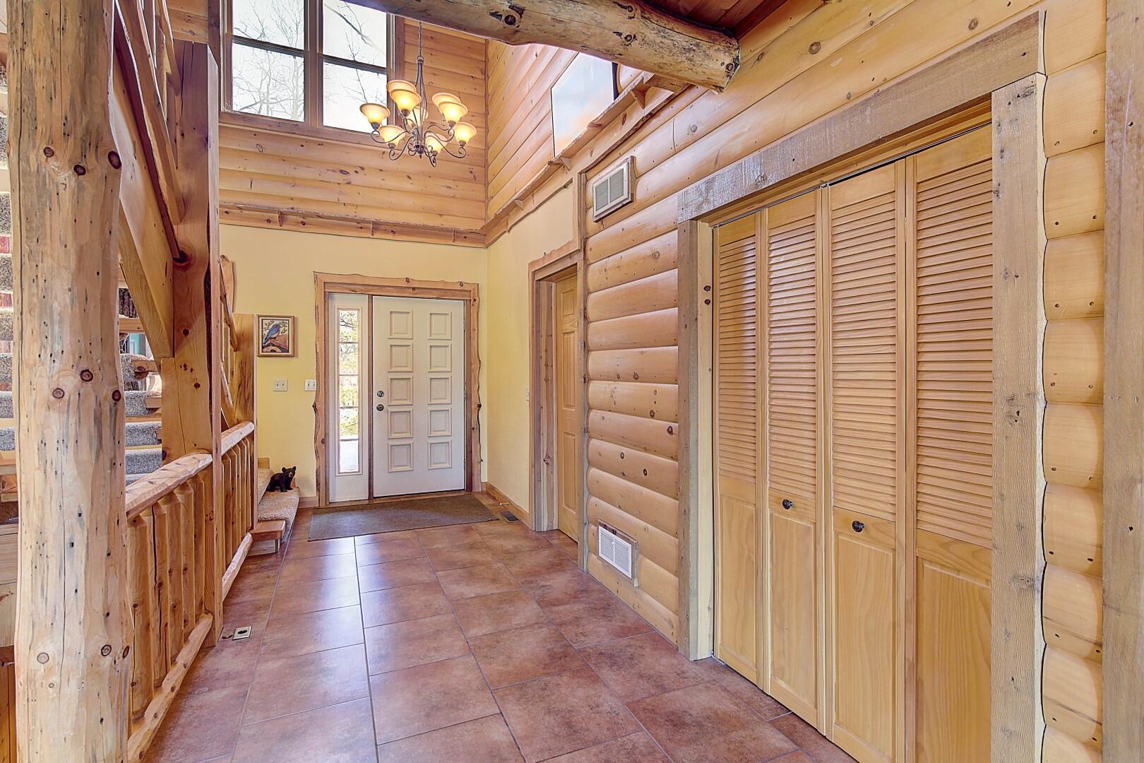 2-story Foyer w/  1/2 Bath & Coat Closet