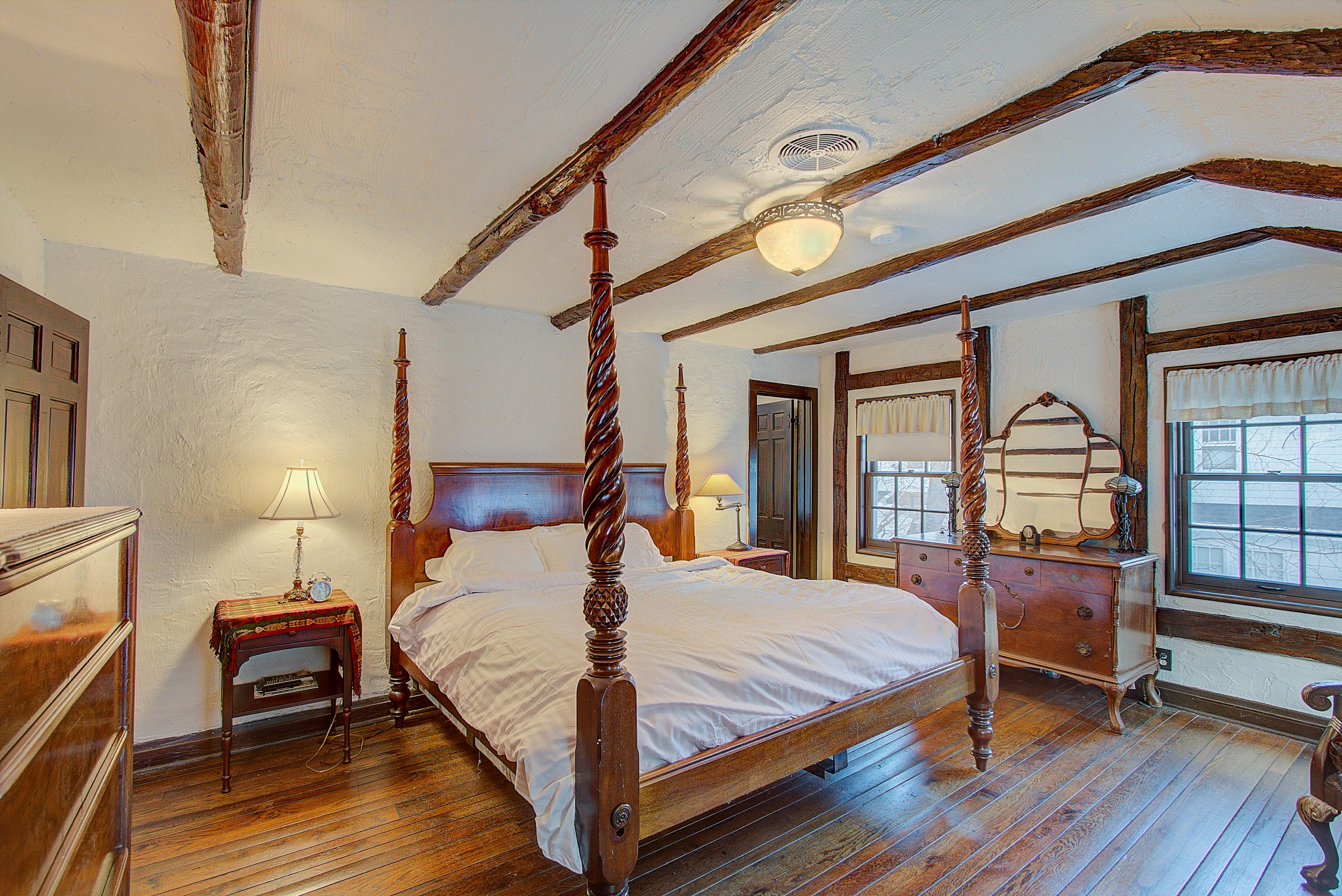 bedroom with attached half bath