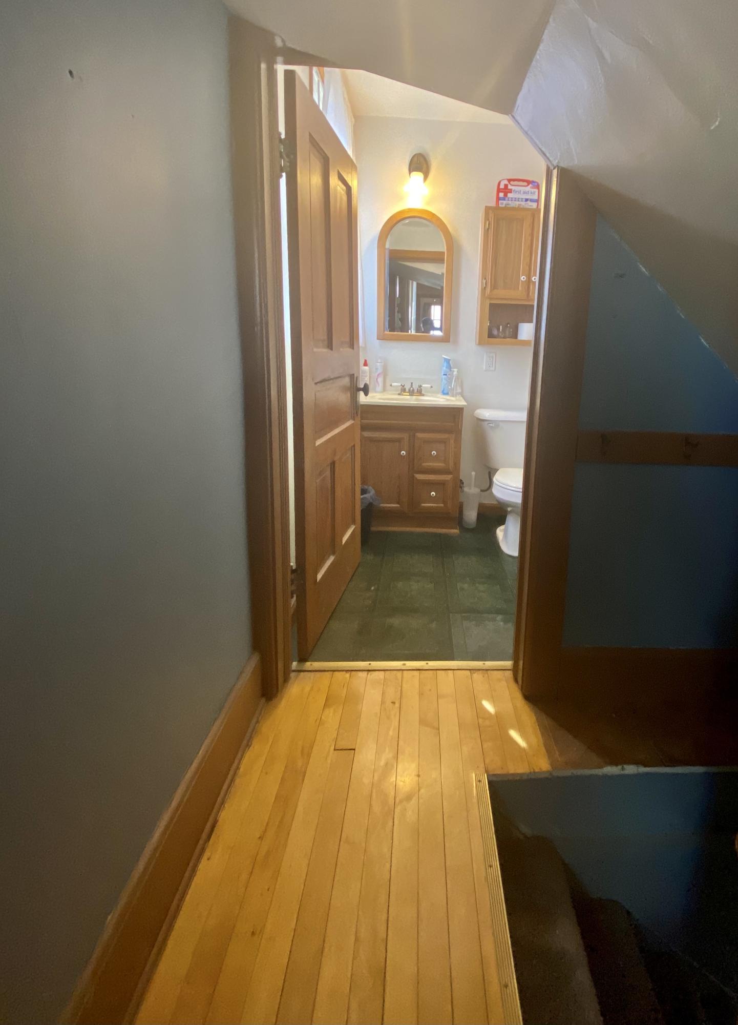 hallway to half bath