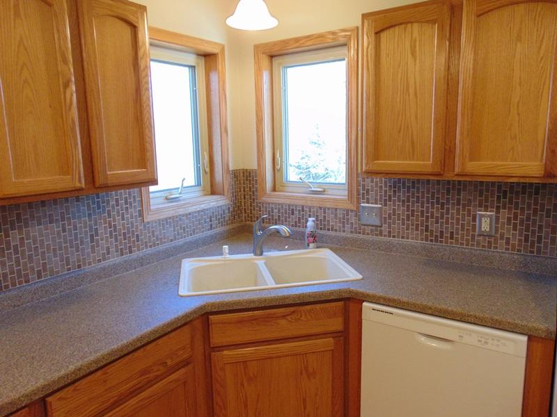 Corner Sink with Tile Backsplash