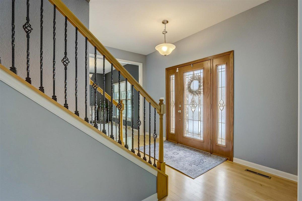 Iron balusters on wooden staircase