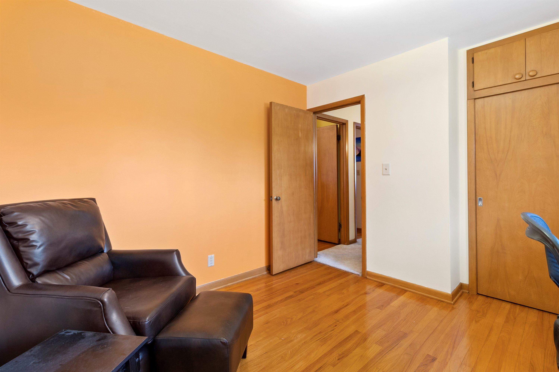 Bedroom 3 with hardwood floors