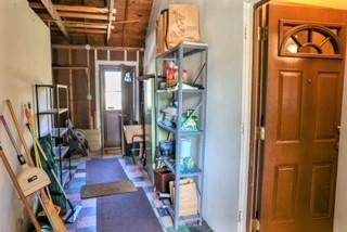 Hallway or mudroom between garage and ho