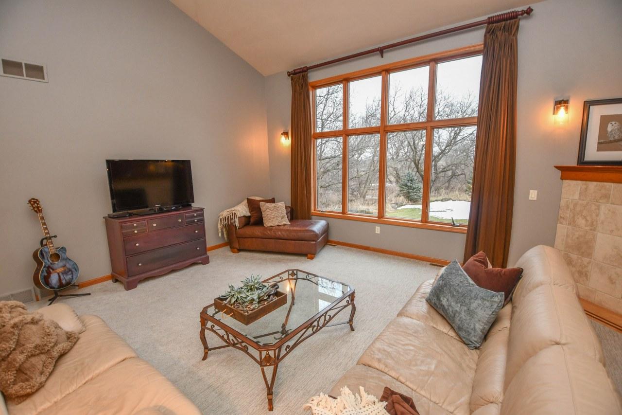 Living Room looks to Backyard