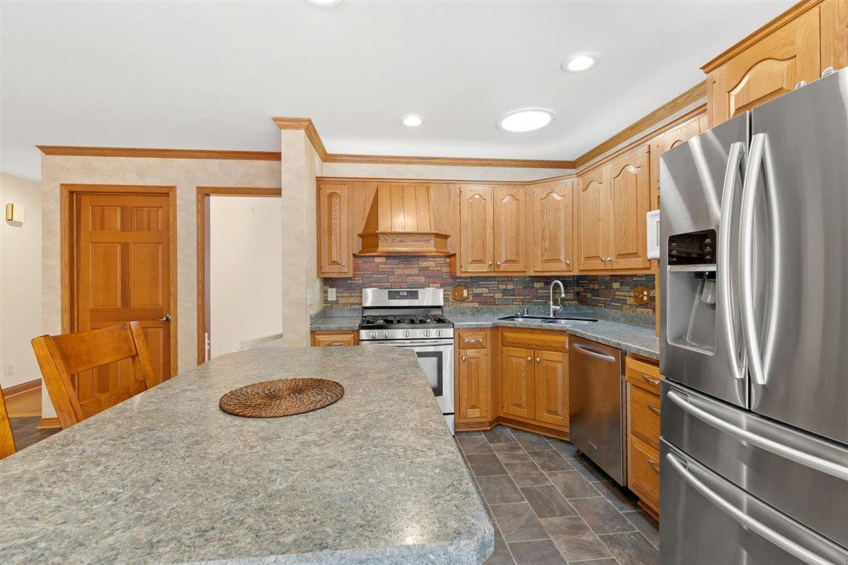 Kitchen with island and stainless applia