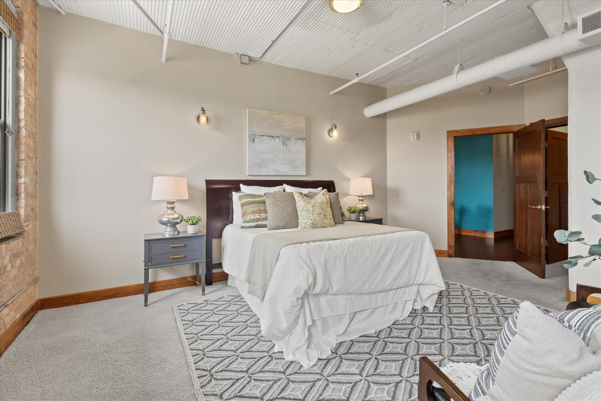 Spacious bedroom with neutral colors