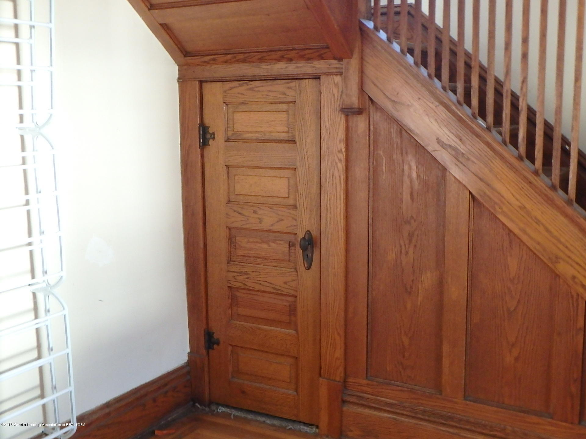 original woodwork by open staircase:  109 W Stoddard