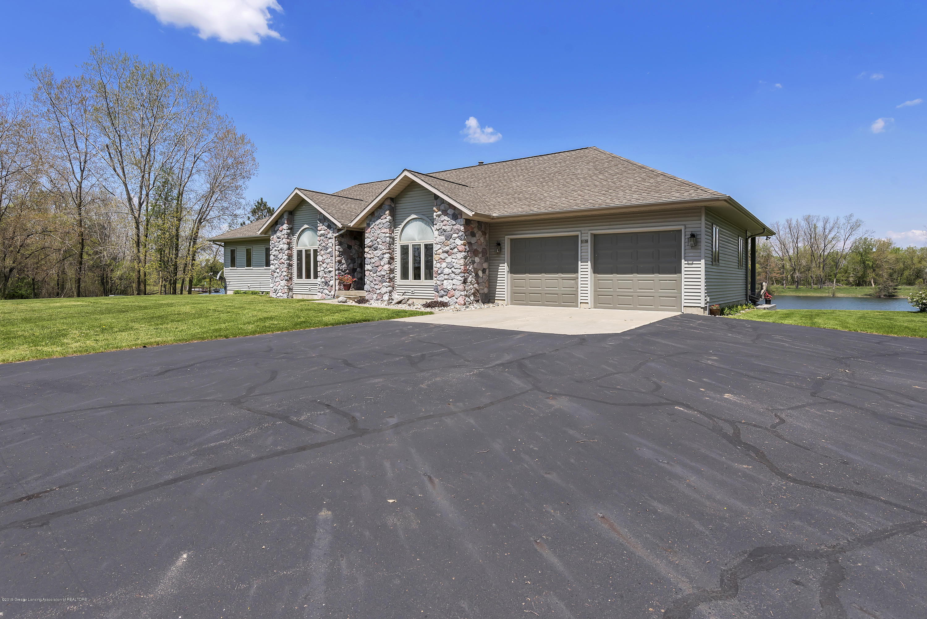 Front view with paved driveway:  8558 Ironstone Drive