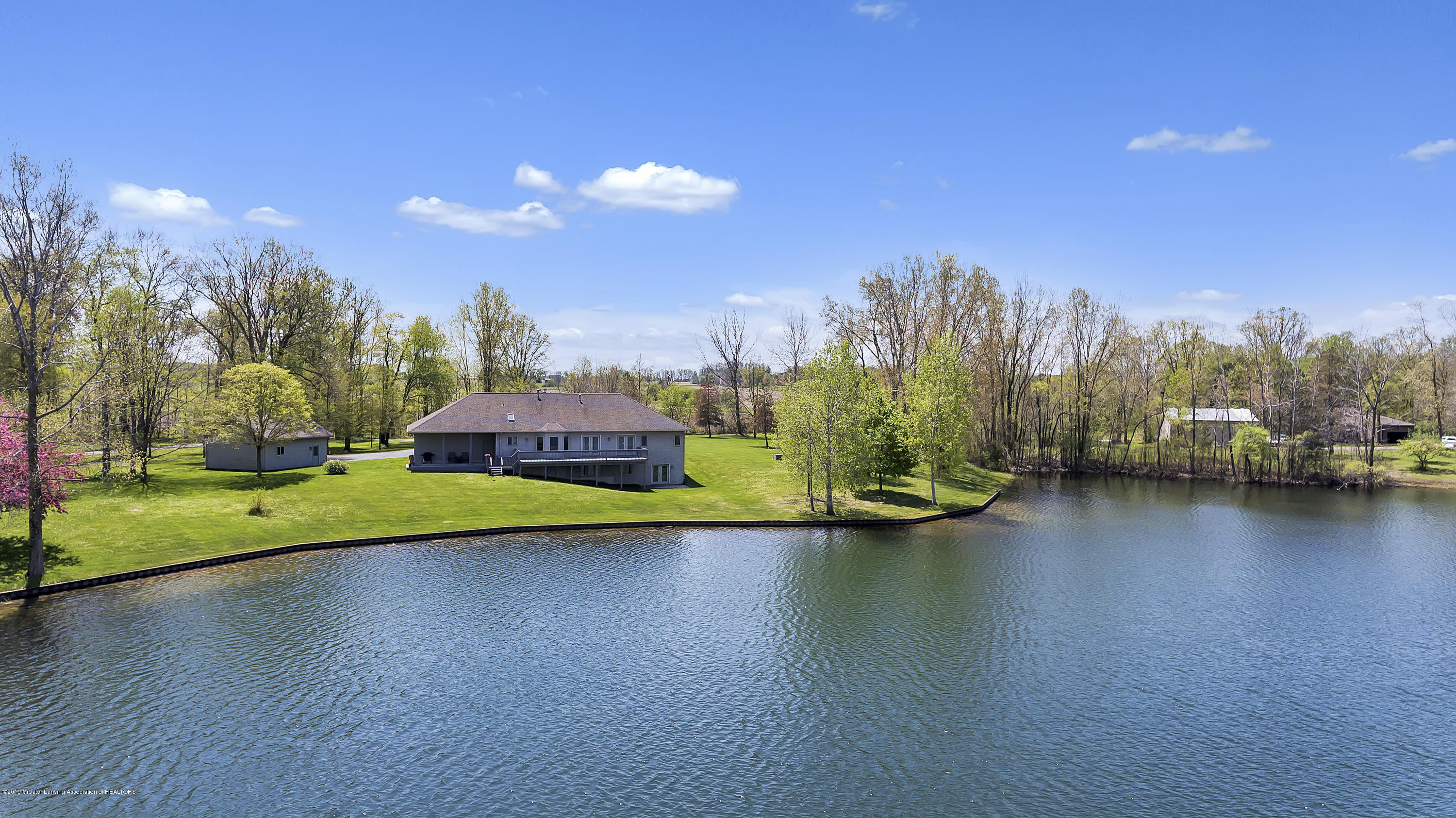 view of house and lake +:  8558 Ironstone Drive