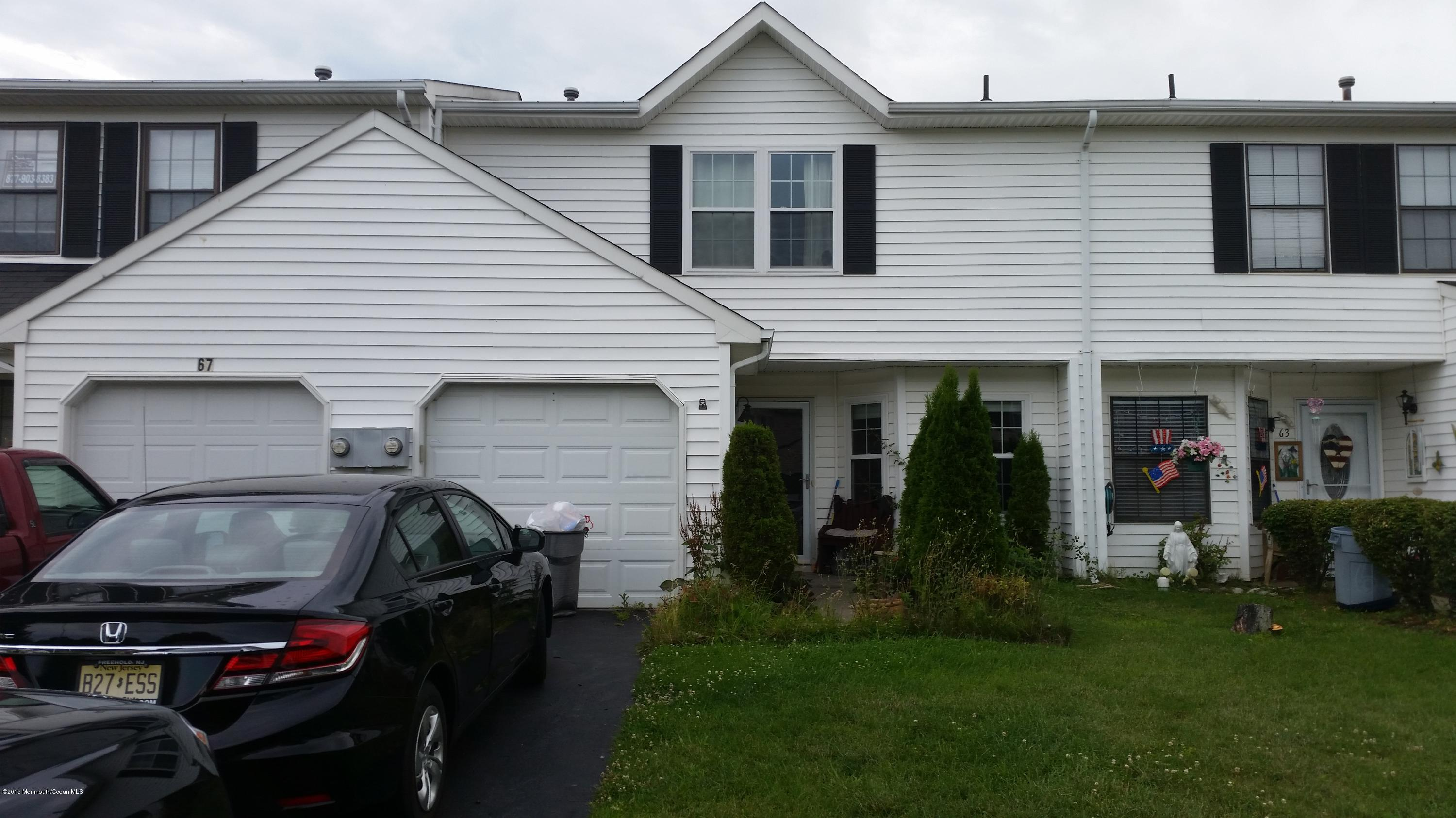 Photo of home for sale at 65 Harbor Circle Circle, Freehold NJ