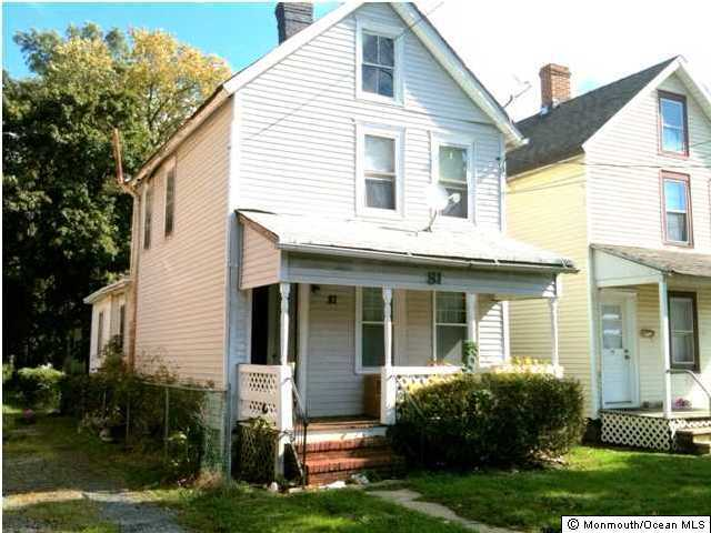 Photo of home for sale at 81 Throckmorton Street Street, Freehold NJ