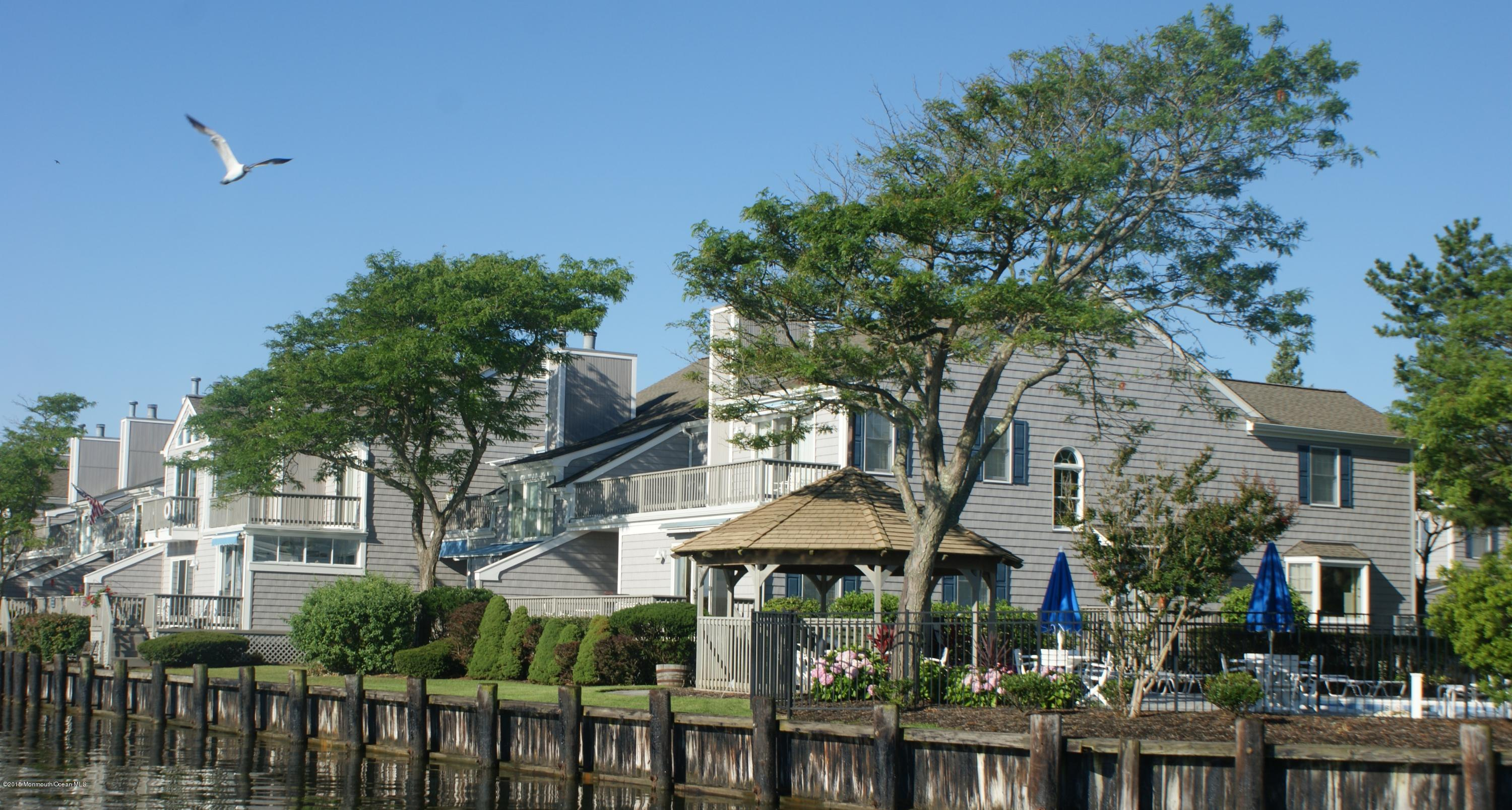 Photo of home for sale at 62 Bay Point Harbour, Point Pleasant NJ