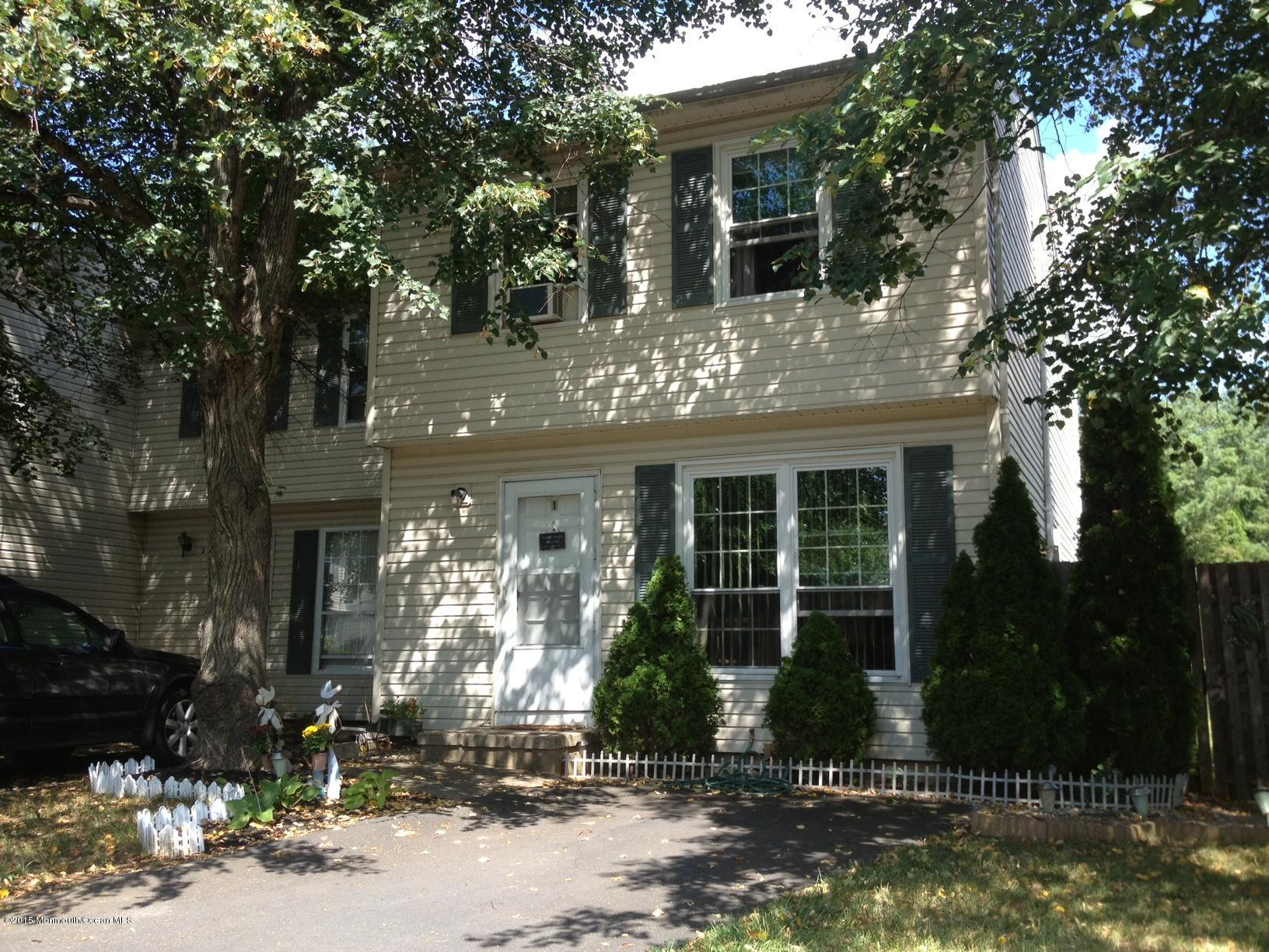 Photo of home for sale at 1 Dobbs Court Court, East Brunswick NJ