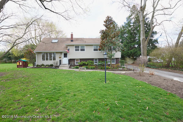 Photo of home for sale at 89 Woodside Drive Drive, Red Bank NJ