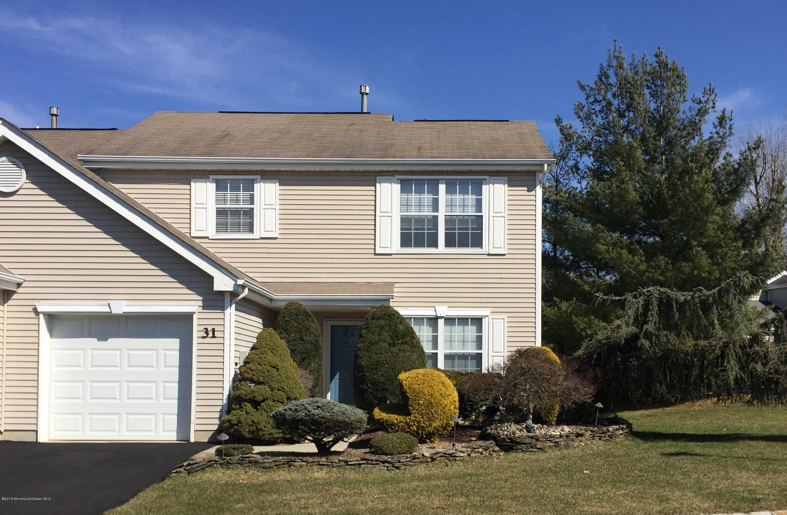 Photo of home for sale at 31 Hemlock Way Way, Freehold NJ