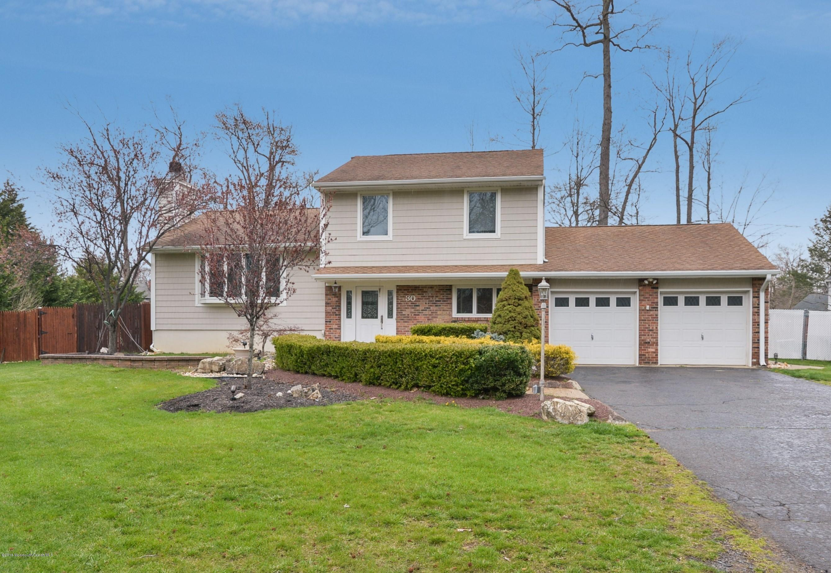 Photo of home for sale at 30 Birmingham Drive Drive, Manalapan NJ