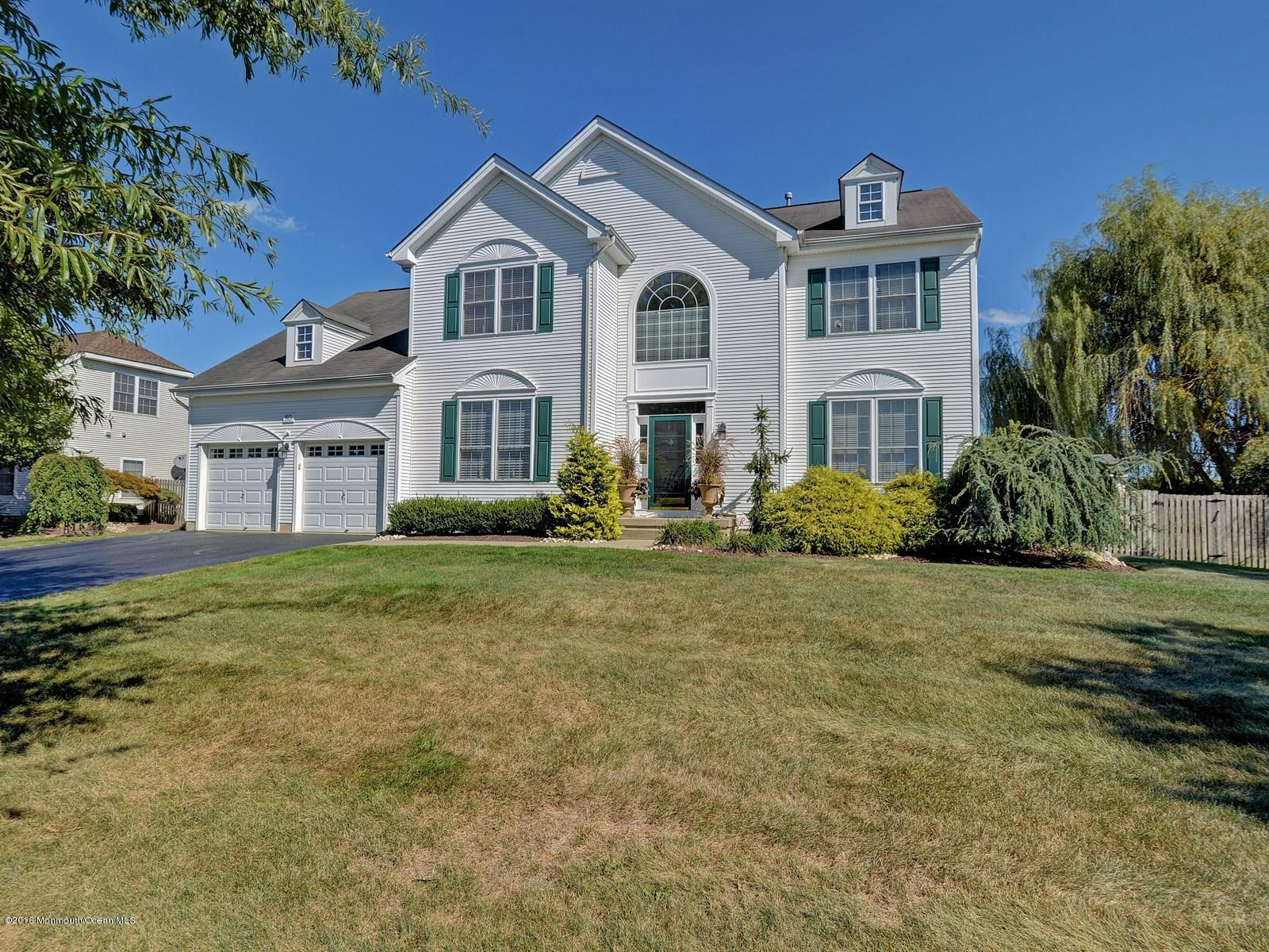 Photo of home for sale at 80 Princeton Oval, Freehold NJ