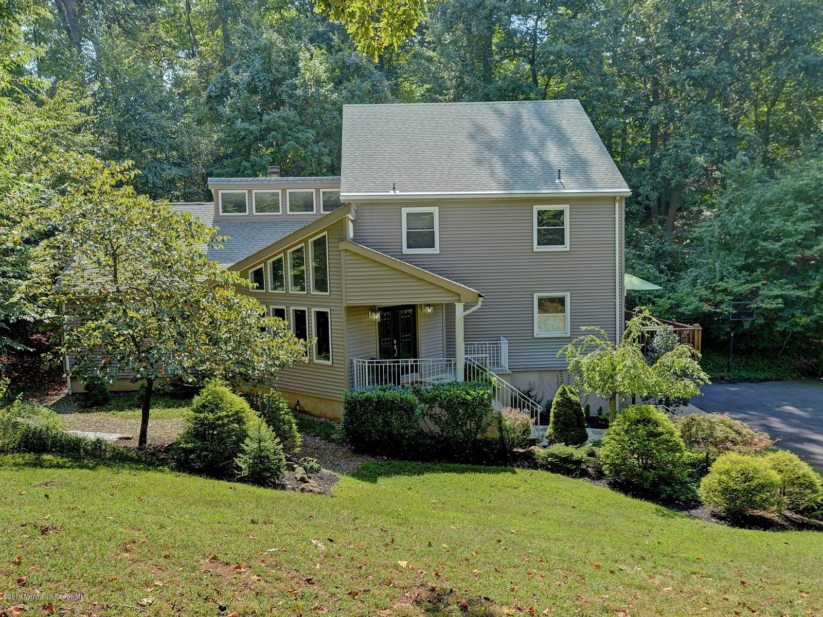 Photo of home for sale at 57 Reids Hill Road Road, Morganville NJ
