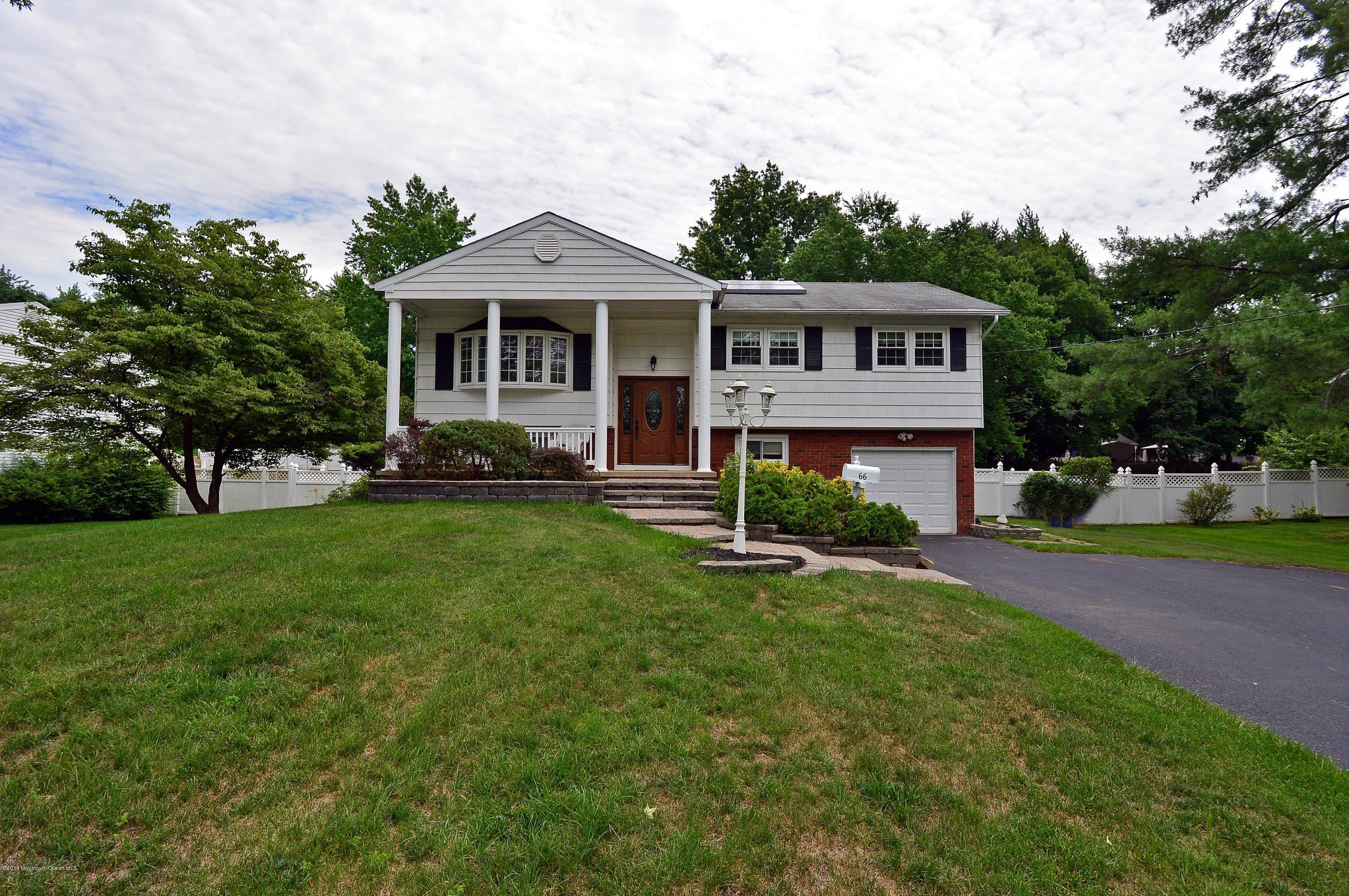 Photo of home for sale at 66 Old Queens Boulevard Boulevard, Manalapan NJ