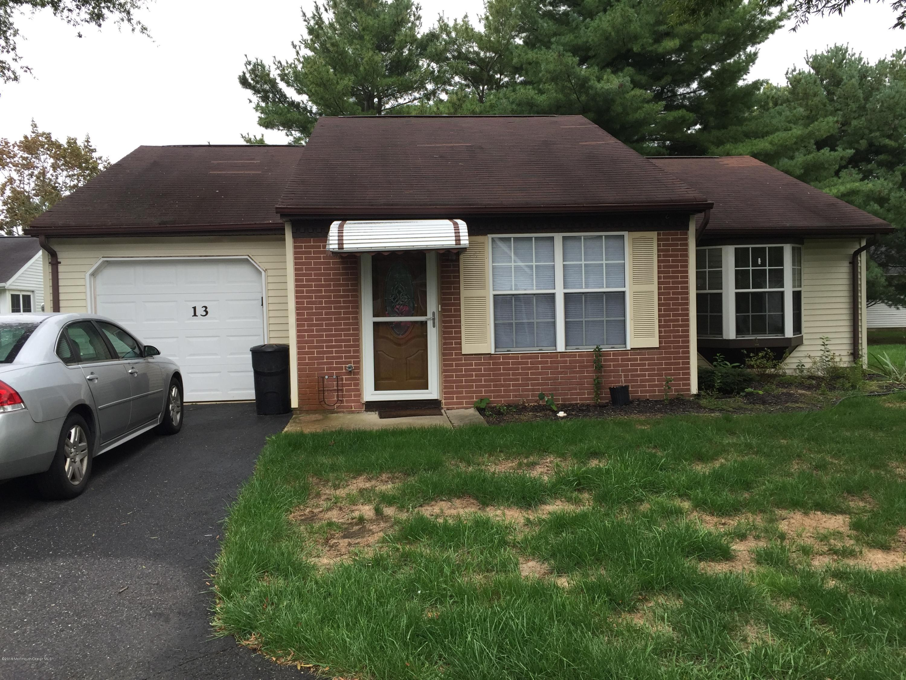Photo of home for sale at 13 Jaffreyton Close, Freehold NJ