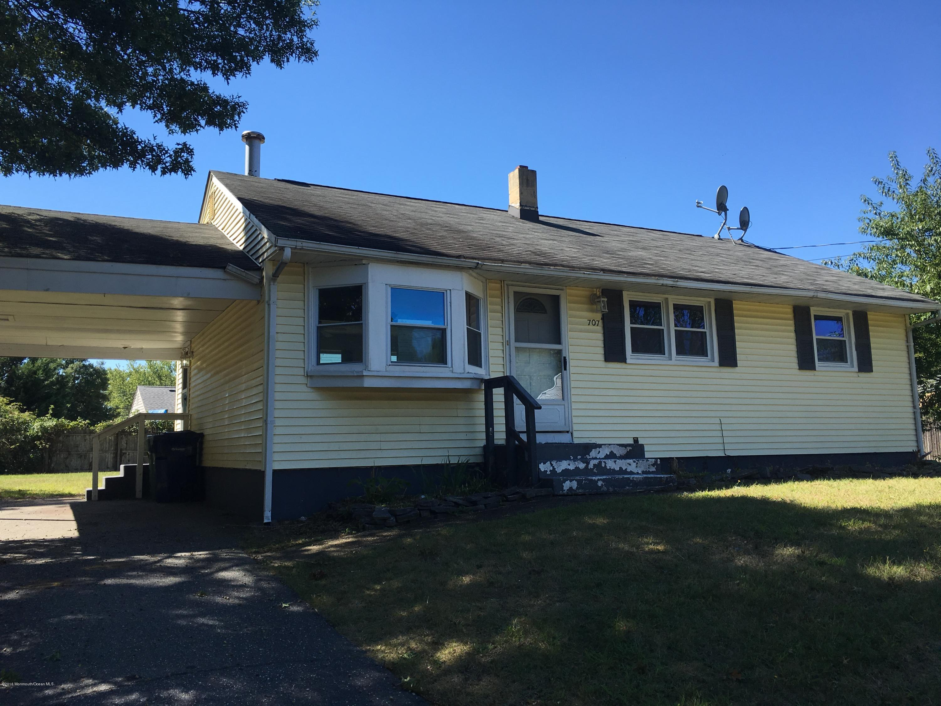 Photo of home for sale at 707 Lawn Drive Drive W, Neptune Township NJ