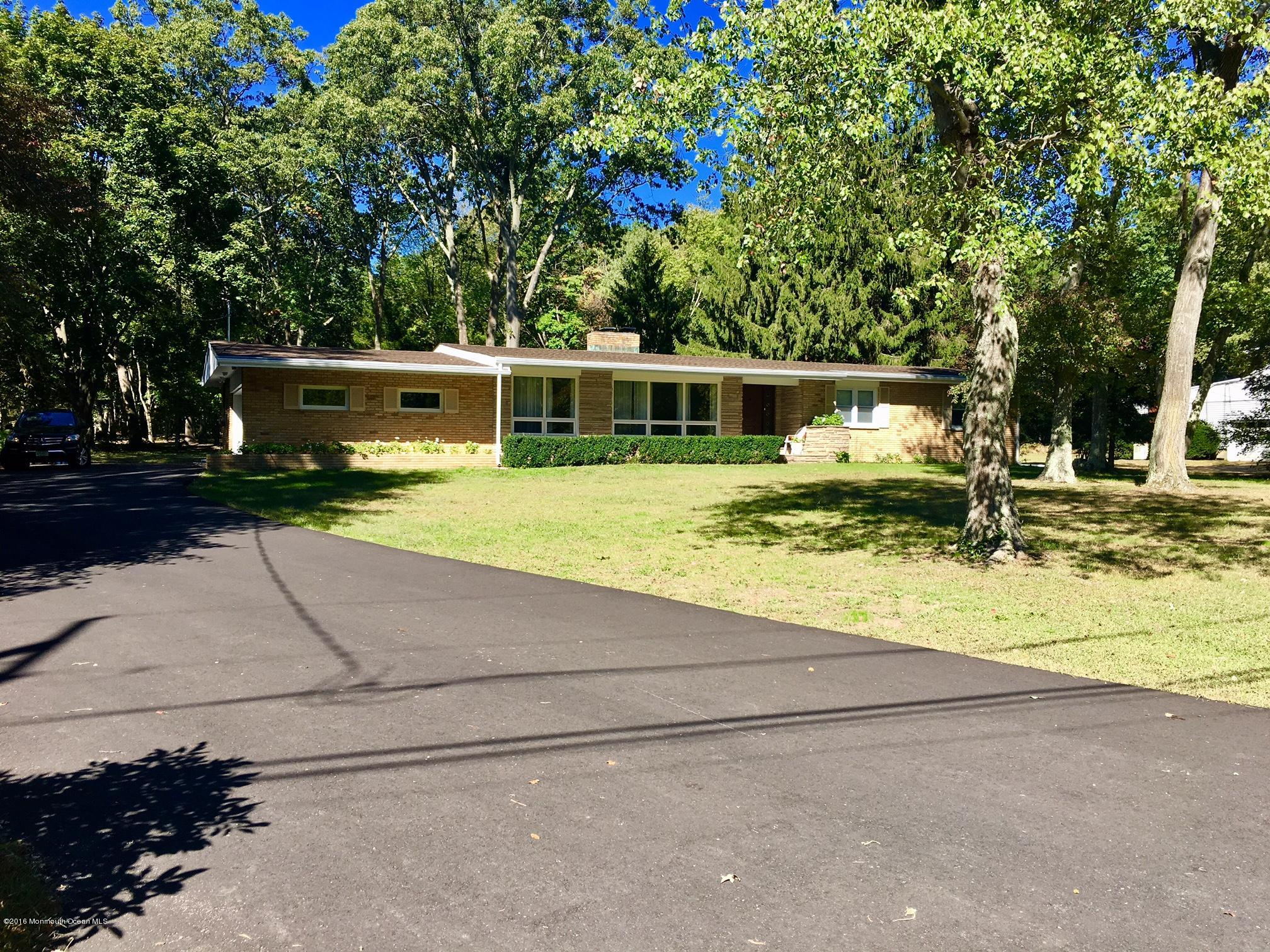 Photo of home for sale at 1251 Deal Road Road, Ocean Twp NJ