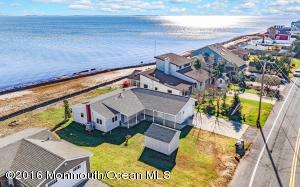 (Click the TOUR link to see many more photos and view a drone video of breathtaking view of open bay clear to Barnegat Lighthouse and Bay Front Park Construction).  Truly breathtaking views from this completely renovated bay front home. Get in early before the Forked River Beach Bay Front Park is completed (this park is apart of the Ocean County Park System and a short walk from 1602 Beach Blvd).  The new park will have a running path along the water and will be a peaceful escape from the norm.  Home renovated by top builder in the area.  New kitchen, new bath, granite, molding etc.Too many upgrades to list. The pictures do not lie, enjoy the sunrise from your living room 365 days a year.