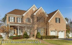 Stately Brick Front Colonial in desirable North Dover section with rocking chair front porch. 4 Bedrooms/2.5 Baths, 2 Car Garage, Full Basement AND In-ground Pool!! Gorgeous home with Gourmet Eat-in Kitchen with 42'' cabinets, center island and granite countertops!  Sunken 2 story family room with high ceiling, large windows and cozy fireplace! Formal Dining room with custom molding! Hardwood floors throughout 1st floor and 2nd floor, spacious bedrooms, Master with walk in closet and luxurious master bath, this home will not disappoint! Plus fenced in yard with inviting in-ground pool!! Beautiful inside and out, a must see!