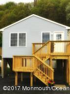 Brand new home in the renaissance town of Highlands. 2 Bedroom; 1 Bath elevated home with captivating views of the Shrewsbury River and Sandy Hook. One block to the Henry Hudson Trail; One block to the SeaStreak ferry for quick and easy access to NYC; One block to the hottest new restaurant on the Jersey Shore- Joe's Bay Pointe Inn. Whether you're looking for a summer hide-away, or full time residency this is a charming place to call your own!