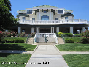 Welcome to your new home at the shore!Spacious and bright with open concept living and just blocks to the beach.This beautiful unit features wood floors throughout, granite, stainless appliances, washer and dryer, soaring ceilings, custom vanity and huge windows.  Master bath with large walk-in closet. There is a basement storage unit and bike rack.  The entry hall is magnificently restored and the perfect way to enter this grand building.   site parking $600 year.