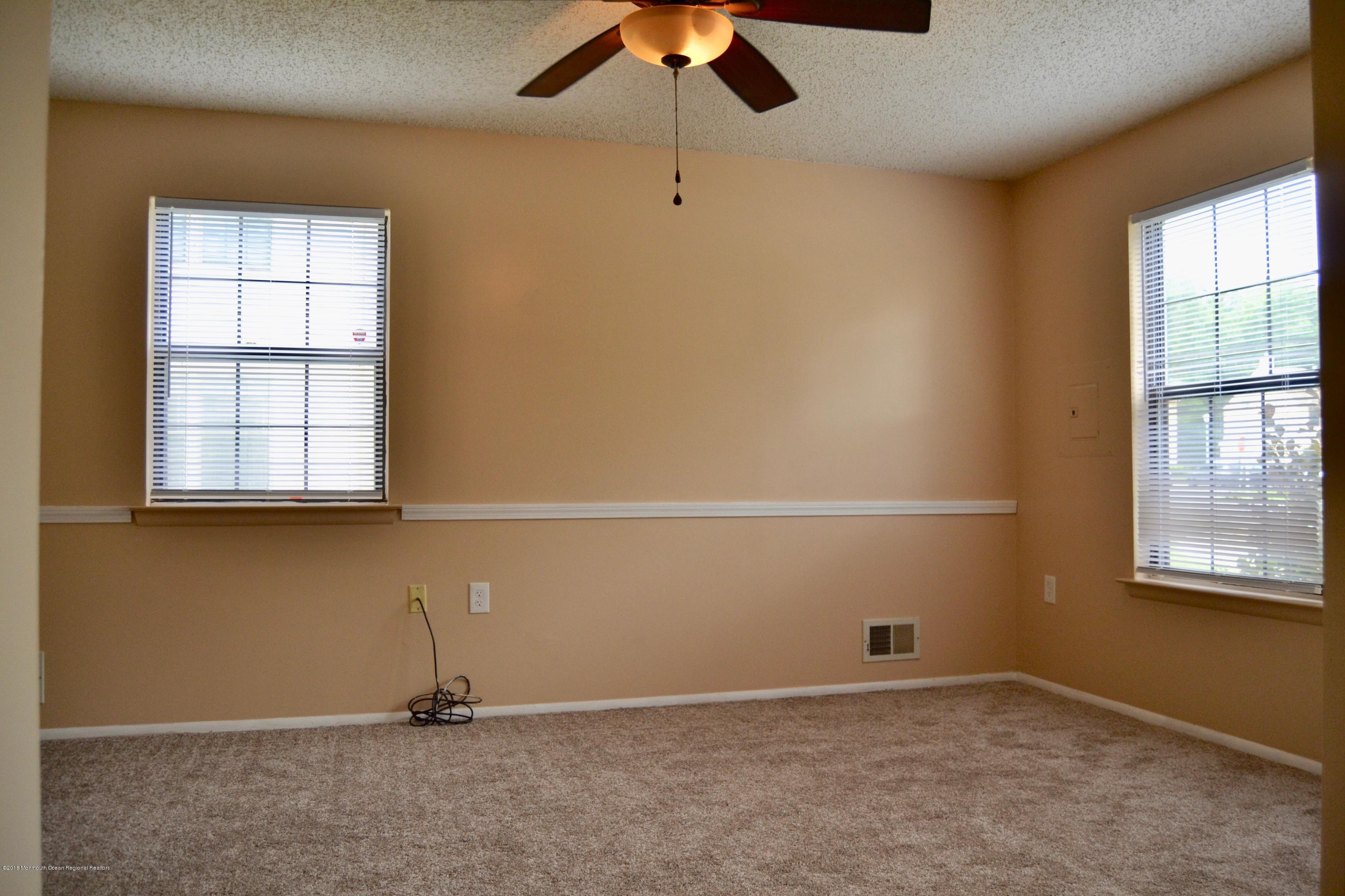 LIVING ROOM WITH NEW WINDOW TREATMENTS