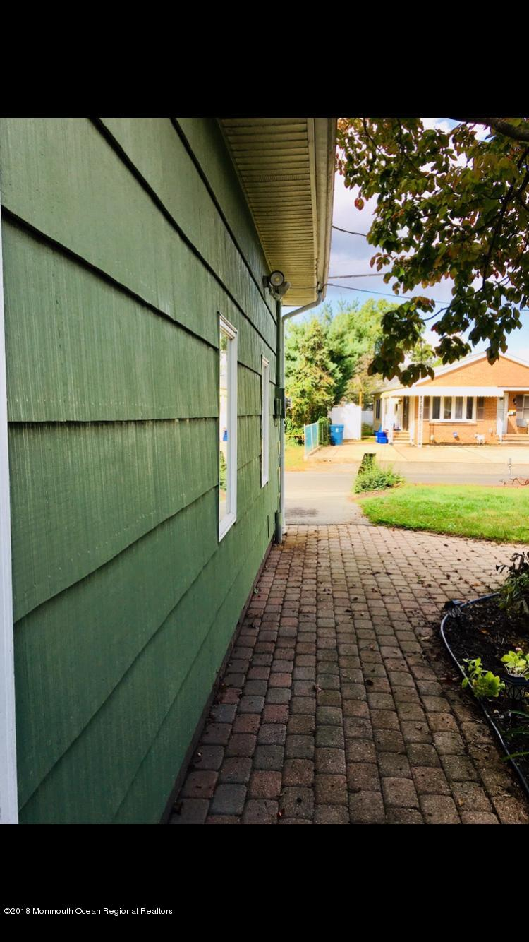 Detached Garage with Paver Walkway