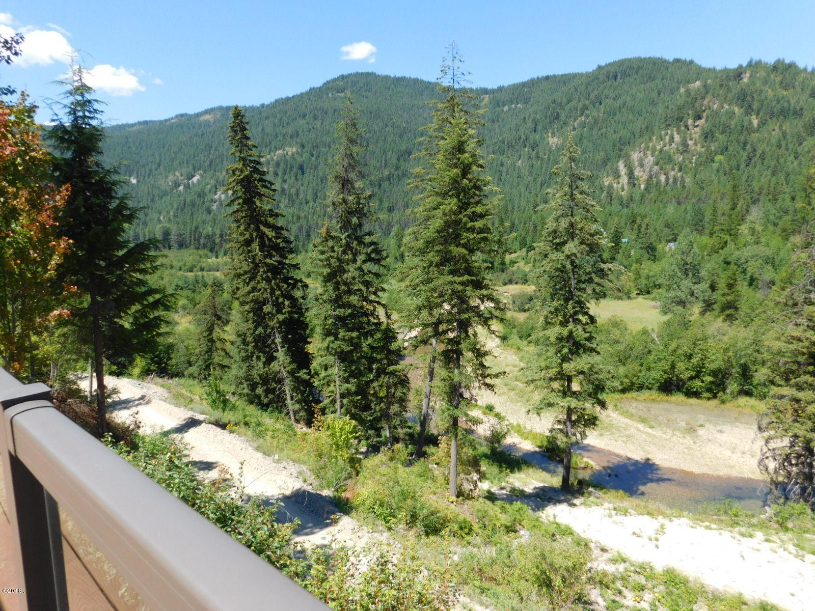 3 bdrm, 2 bath off grid home and property, bordering Forest Service, creek, great views near the Town of Trout Creek, MT
