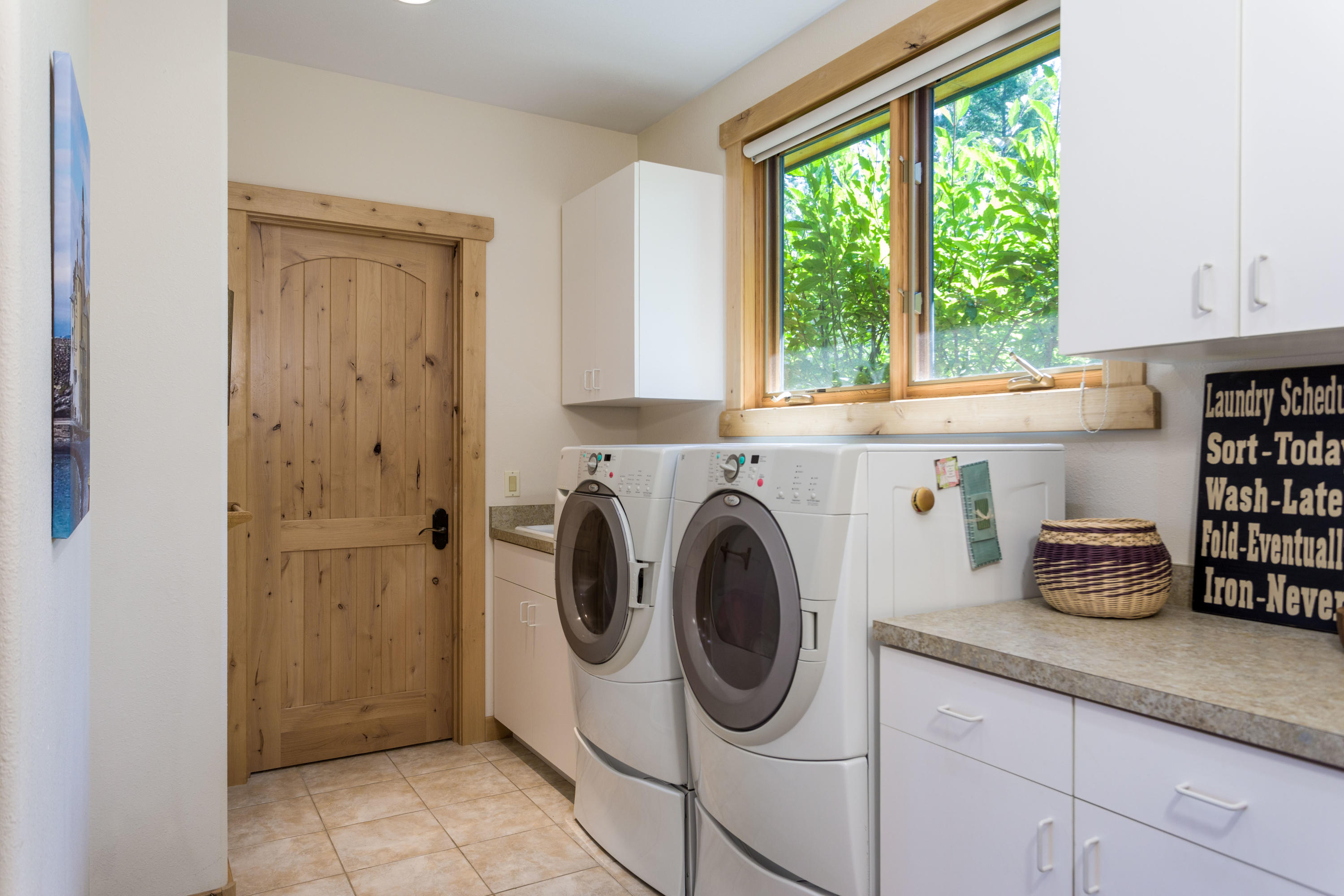 Utility room with walk in storage