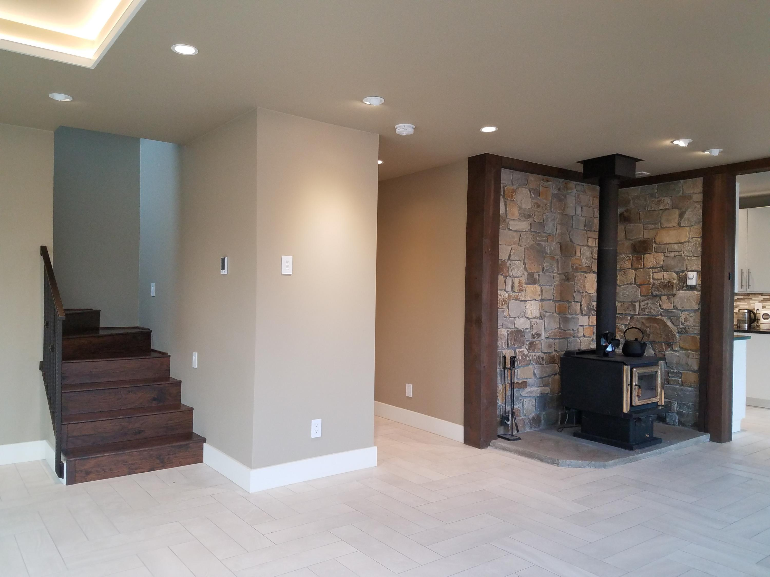 Living area to upstairs, shop, kitchen