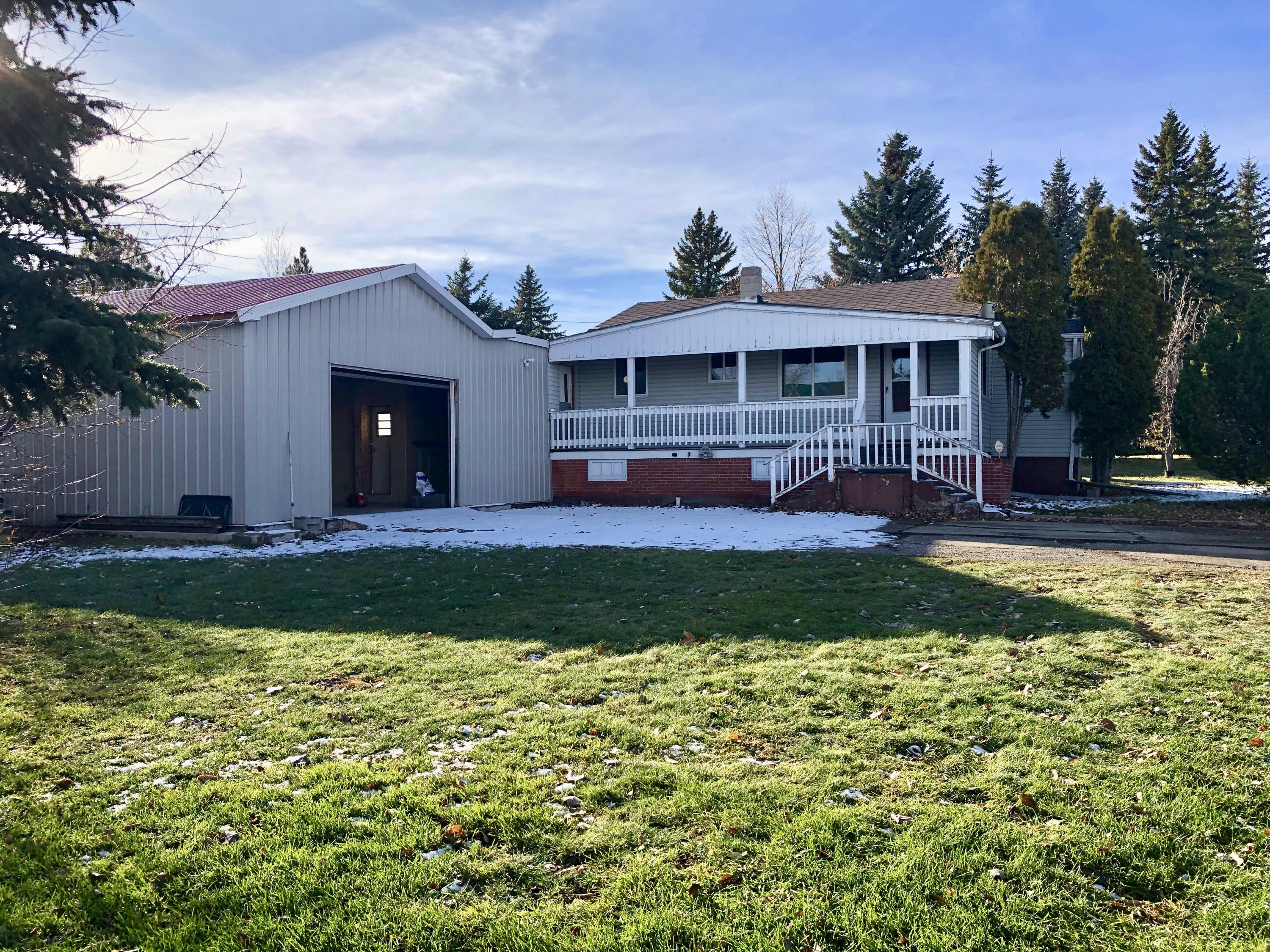 LOOKING FOR A SHOP?  42' X 24'  Shop with Concrete Floor (with Drain), 220V, Workbenches, Shelving, Insulated, Oversized Garage Door with GDO.  Wood Stove Heat.  Close to Market Place AND it Comes with a 3 Bedroom, 2 Bath Home.   Please View the Virtual Tour.  Call Jean Clary 406.868.3961 or Your Real Estate Professional.