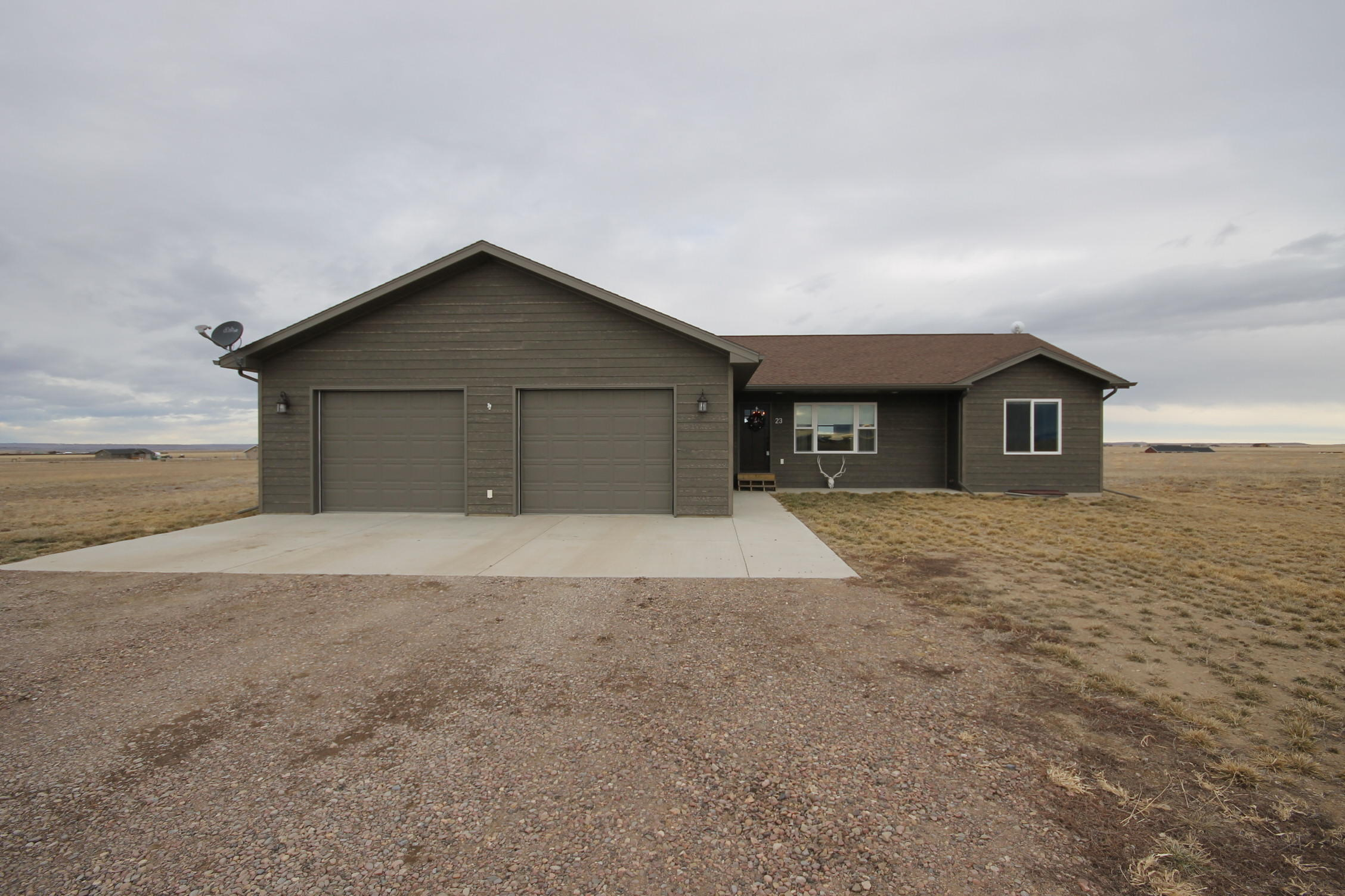 Immaculately cared for almost new construction on 5 acres. Wonderfully planned open layout with tiled bathrooms, eye catching fixtures and much more. The basement is ready to be finished with a tub/shower, rough plumbed bath and walls. Easy care drought resistant lawn and wonderful views! HOA covers road maintenance of weed spraying, grading and snow removal.