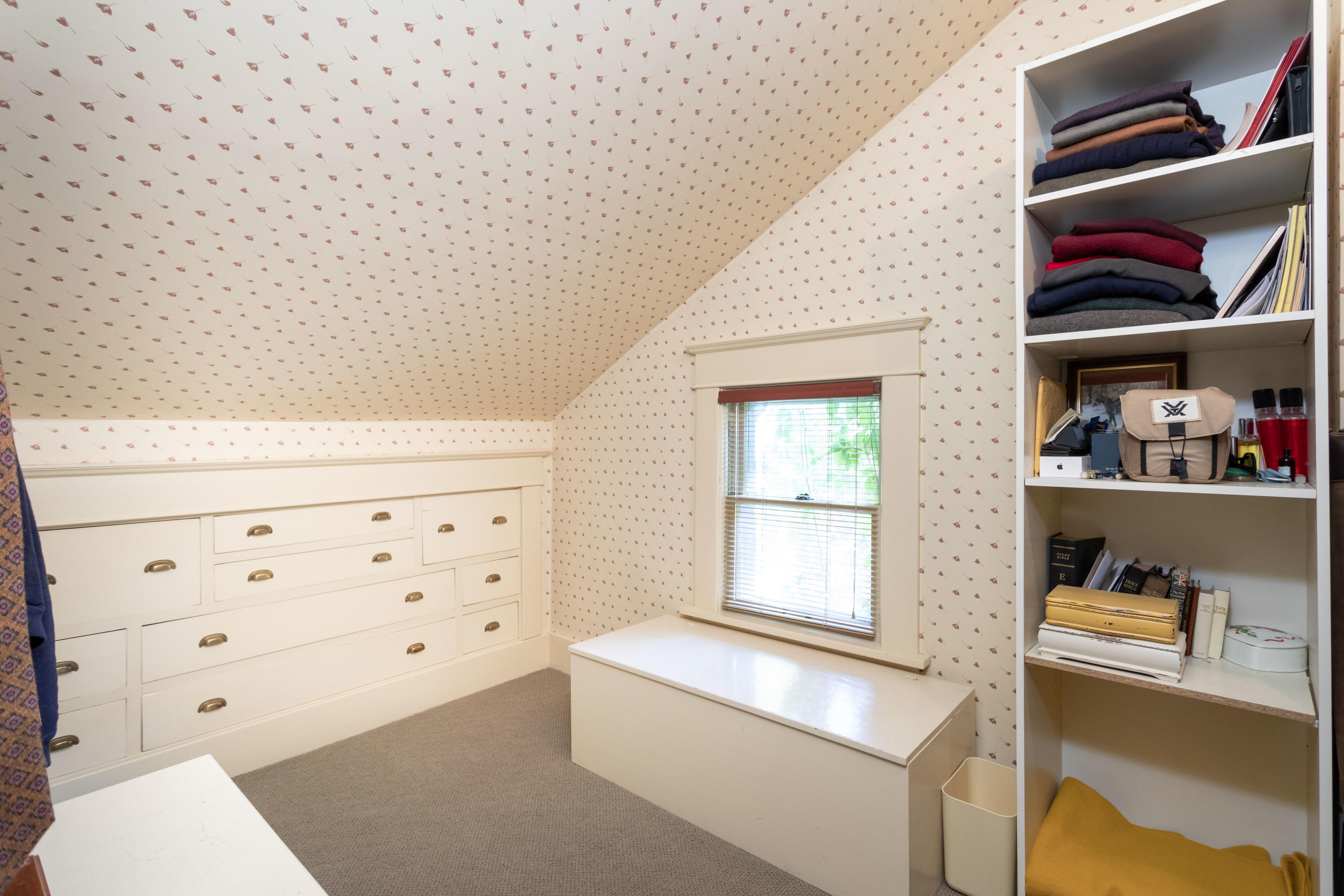 Spacious closet with built in dresser