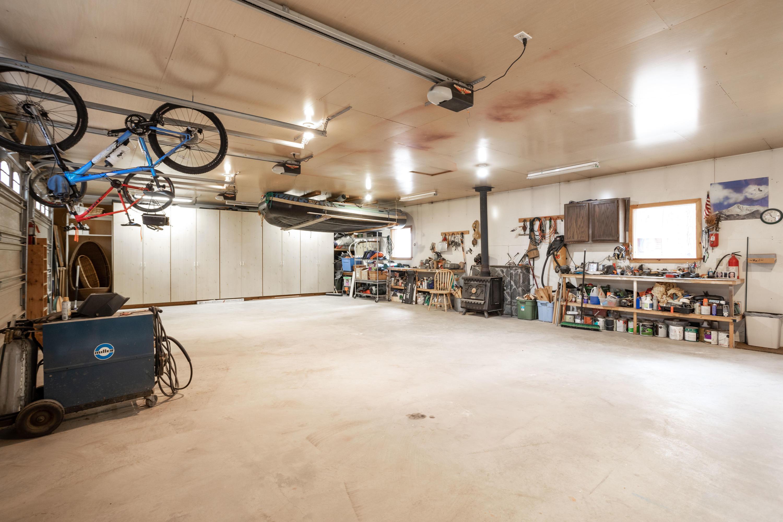 Triple Garage + Storage w/ Wood stove