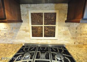 Stacked Stone Backsplash w/ Custom Tile